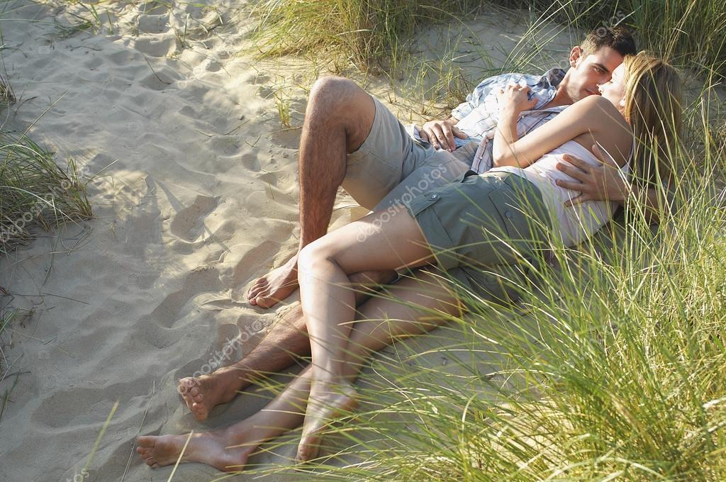 Couple lying and embracing on Beach