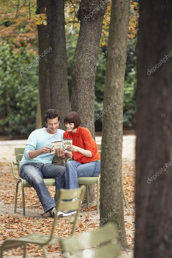 Couple reading guide book