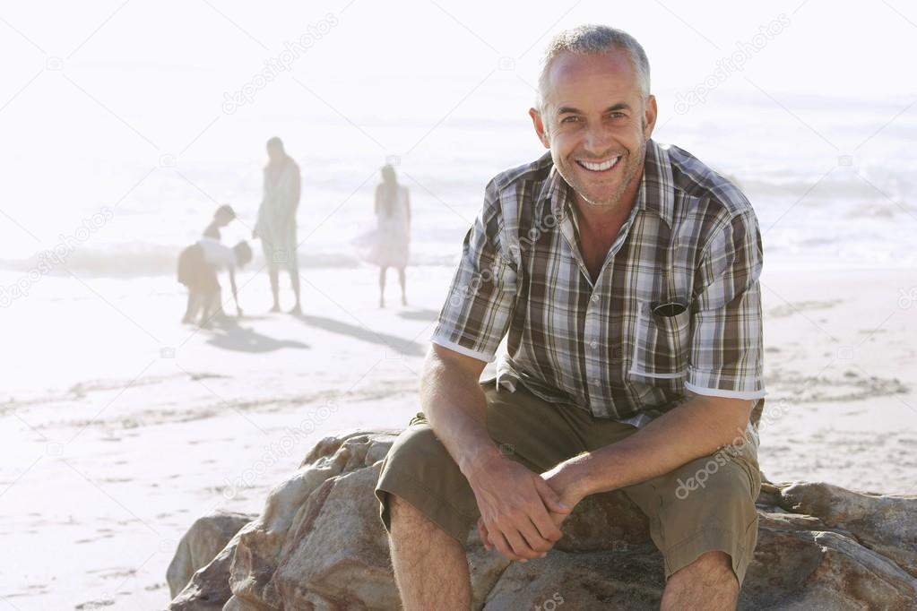 Father With Family at Beach