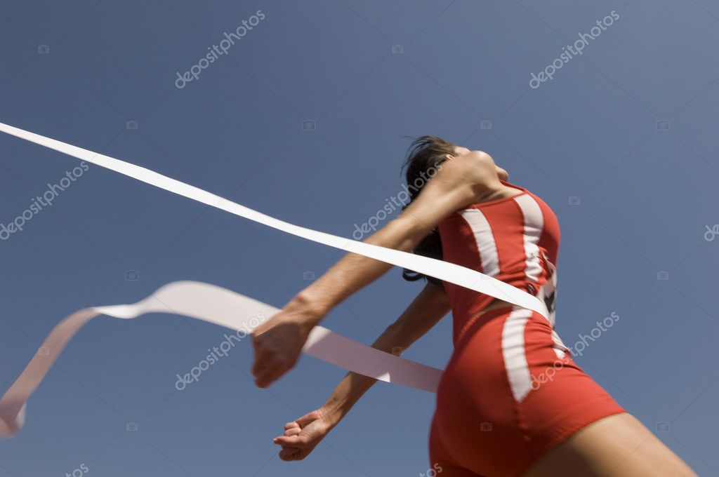 Athlete crossing finish line