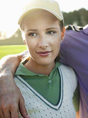 female golfer on court
