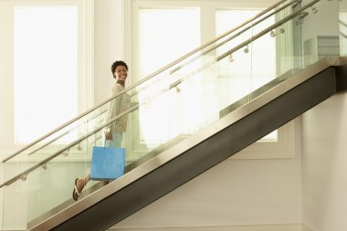 Woman walking up with shopping bag