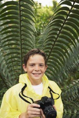 Boy with Camera exploring plants