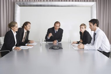 Businesspeople Listening During Teleconference