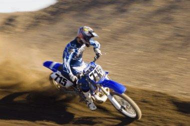 Motocross racer on track