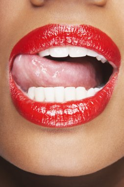 Woman Licking Red Lips