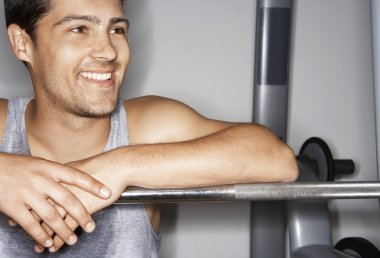 Man resting on barbell