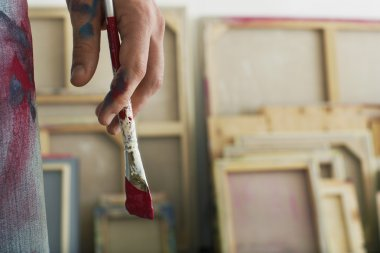 Artist holding paint brush