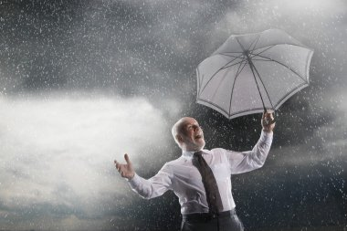 Businessman Laughing in Storm