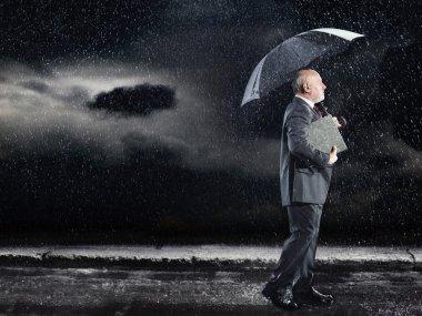 Businessman Walking in rain