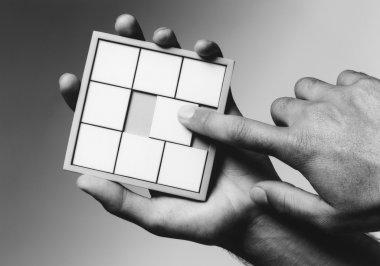 Hands Holding Puzzle