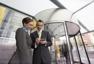 Businessman showing businesswoman PDA