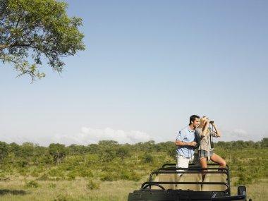 Couple  in safari with binoculars