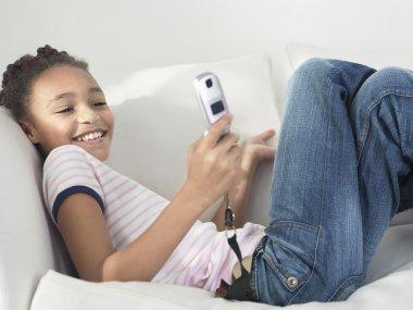 Smiling Girl lying on sofa