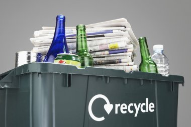 Recycling bin filled with waste paper