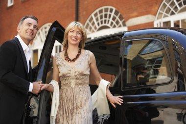 Couple exiting London taxi