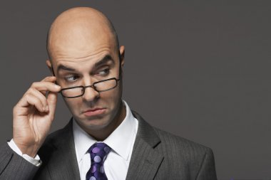 Balding businessman making a face