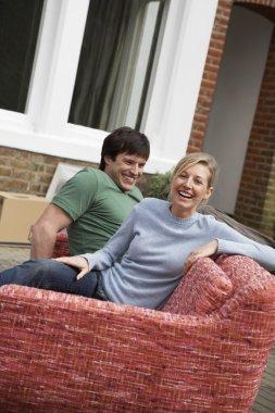 Couple sitting on sofa