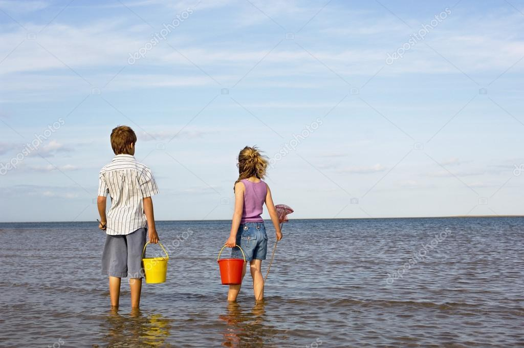 Brother and Sister with buckets and fishnets