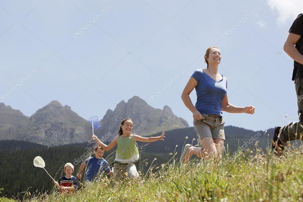 Kids Catching Bugs in Field