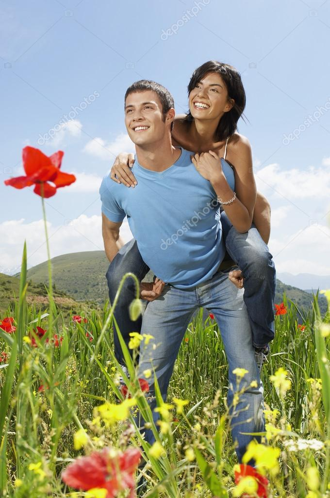Couple in mountain meadow