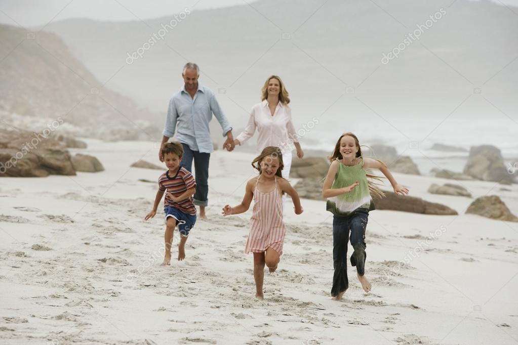 running children on beach