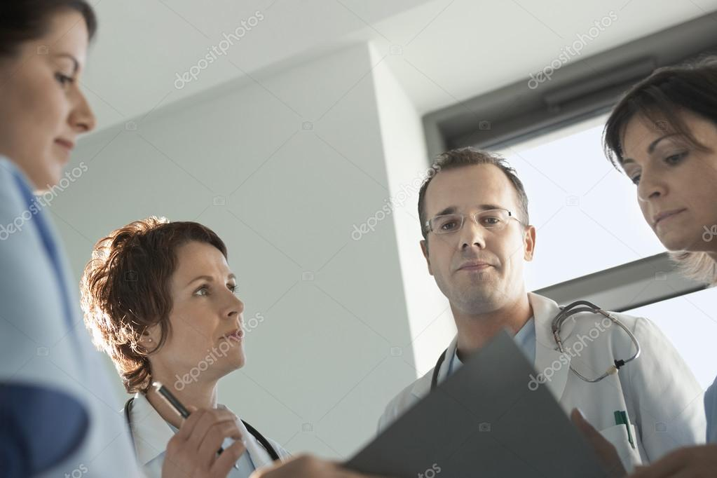 Physicians Reviewing Medical Chart