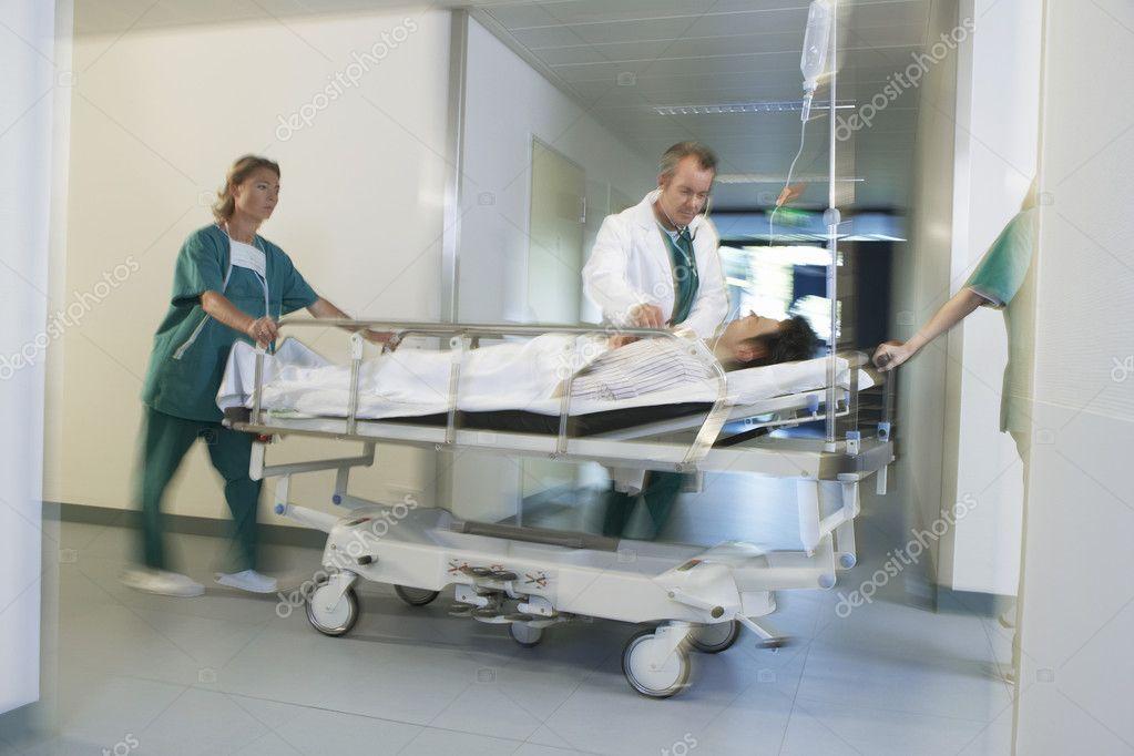 Doctors Moving Patient on gurney