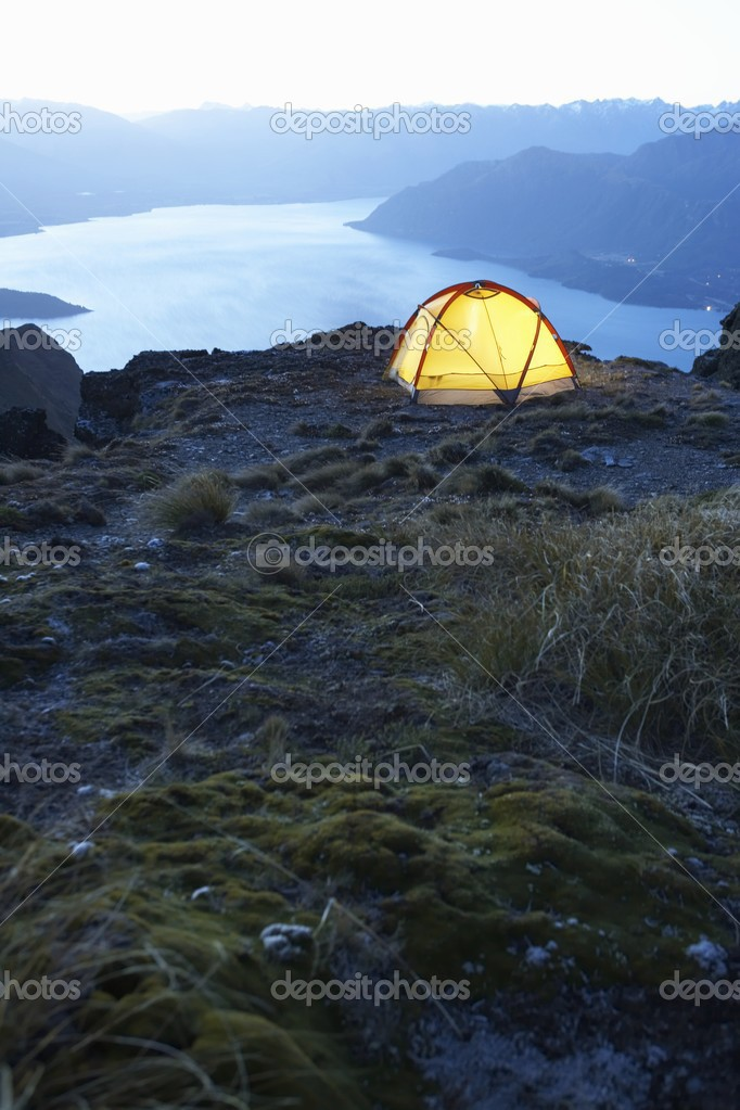Tent on lakeshore at dusk