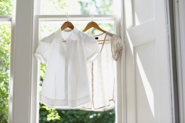 white blouses on Hangers