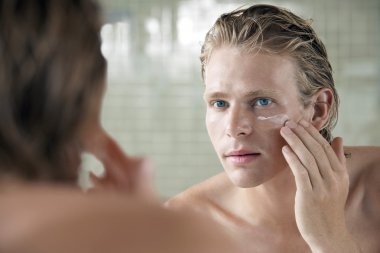 Man Applying Cream