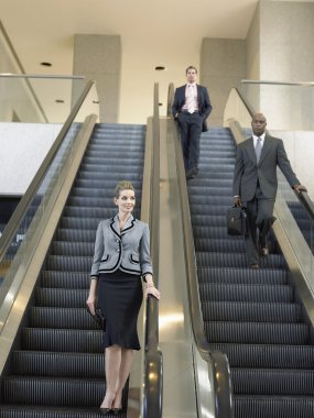 Businesspeople on escalators