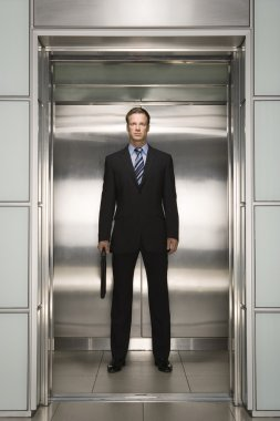 Businessman standing in Elevator