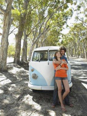 couple embracing over camper van