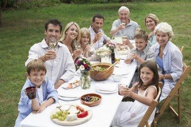 Family dining in garden