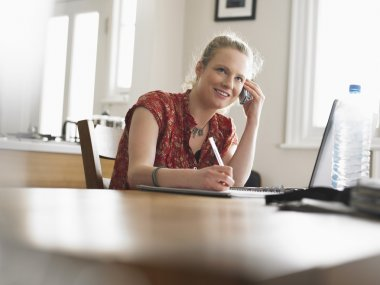 Woman with laptop on table