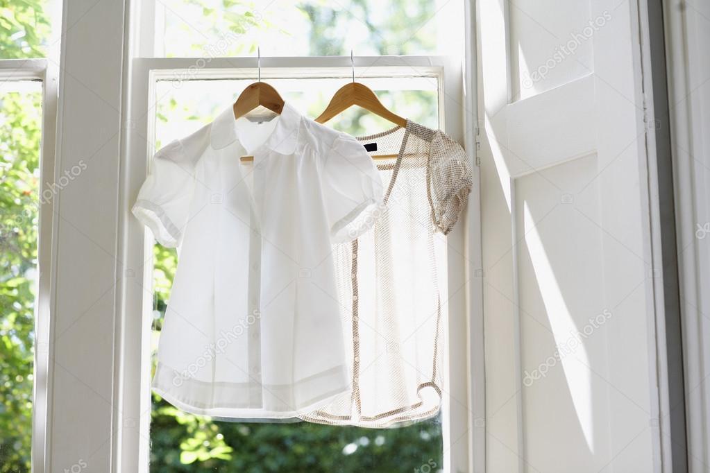 white blouses on Hangers