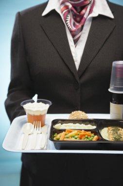 Stewardess holding tray