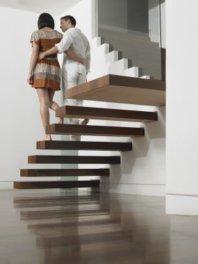 Couple Descending Stairs