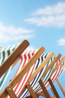 folding deck chairs on beach