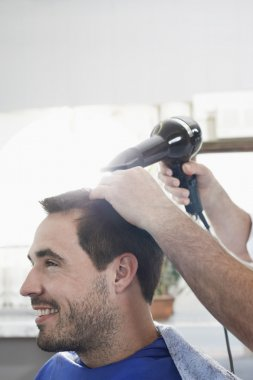 Barber drying  hair