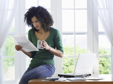 Woman reading paper document