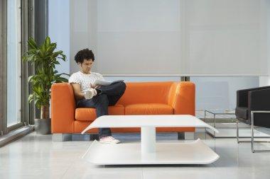 Worker Using Laptop in Lobby