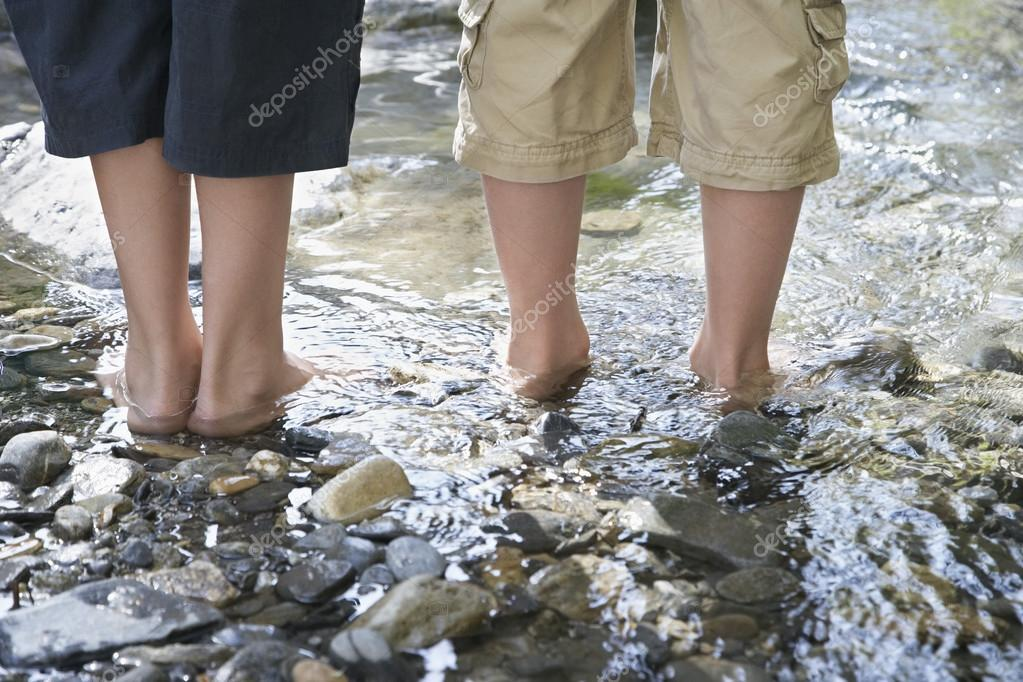 Two boys in stream