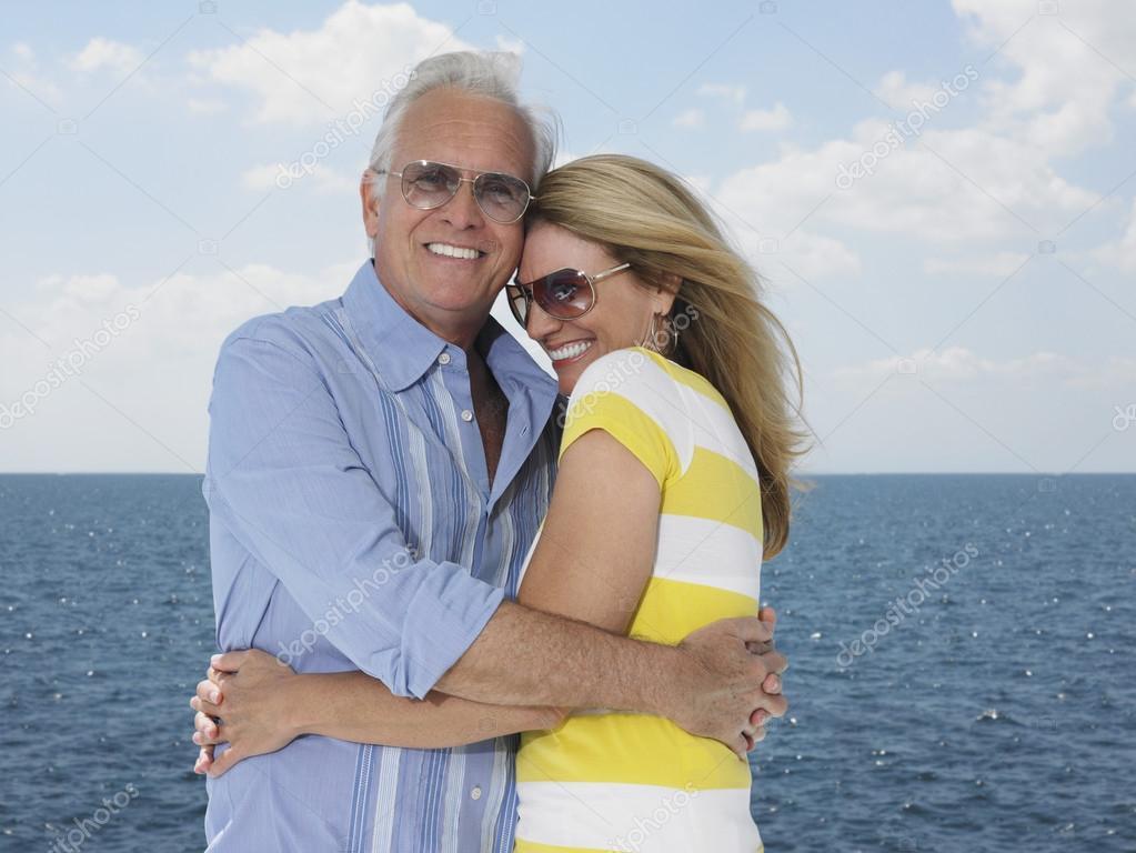 couple embracing against sea