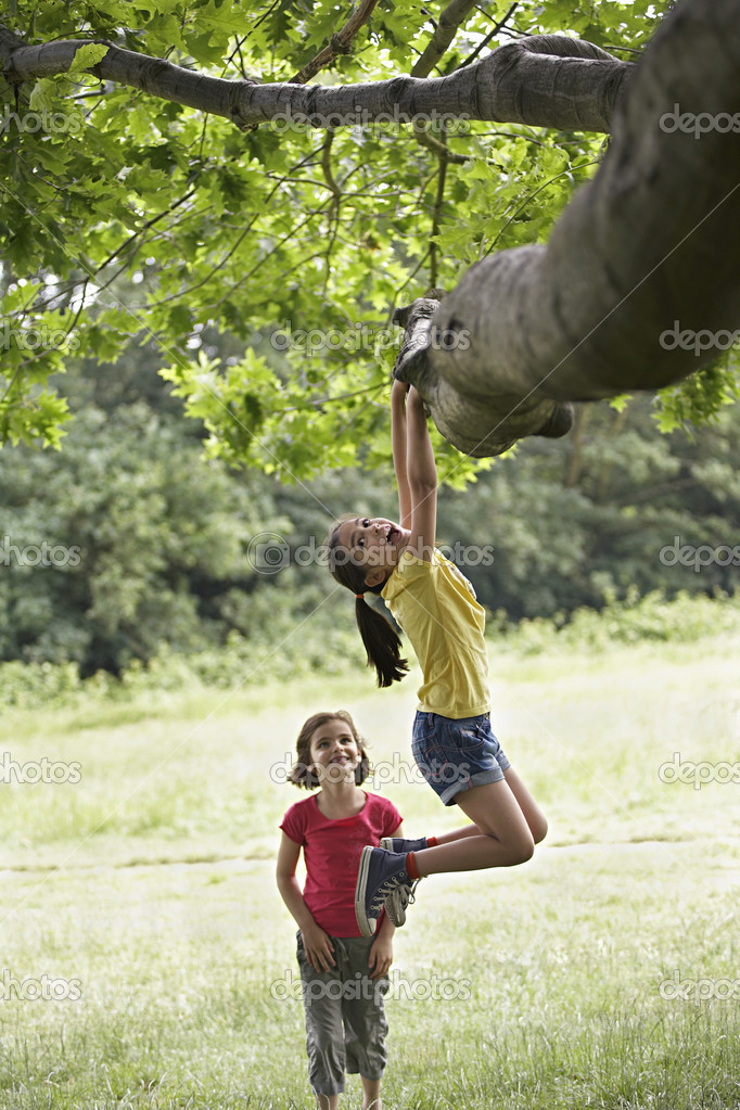Playful Girls at Tree
