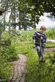 Fotografie Boy gardening with spade