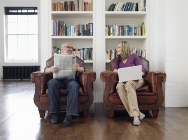 senior Couple resting in Armchairs