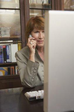 Professor Using Cell Phone