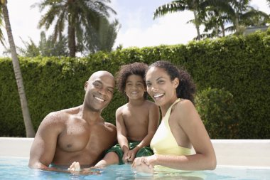 Parents with son  in pool